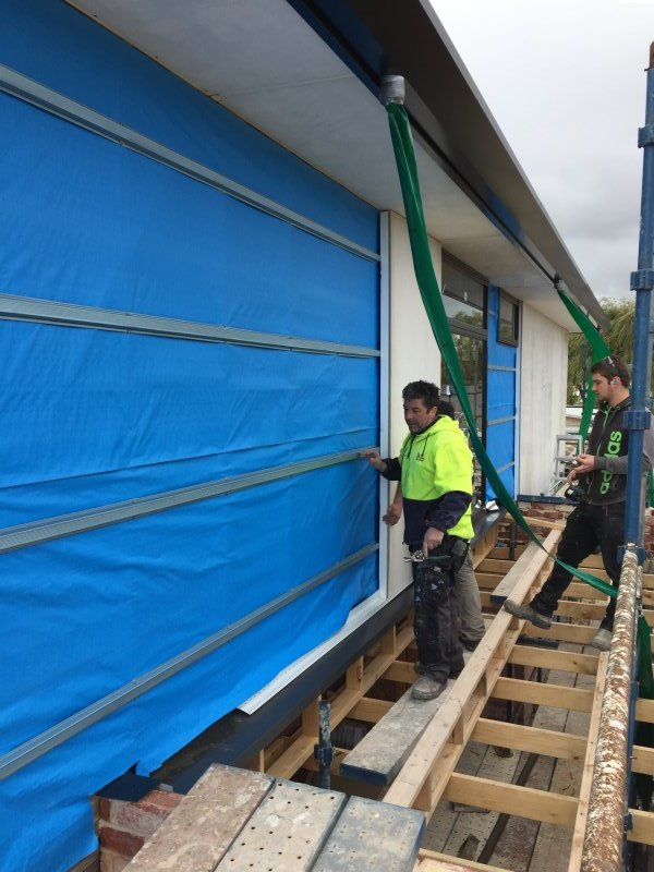 Working to install Structural Insulated Panels